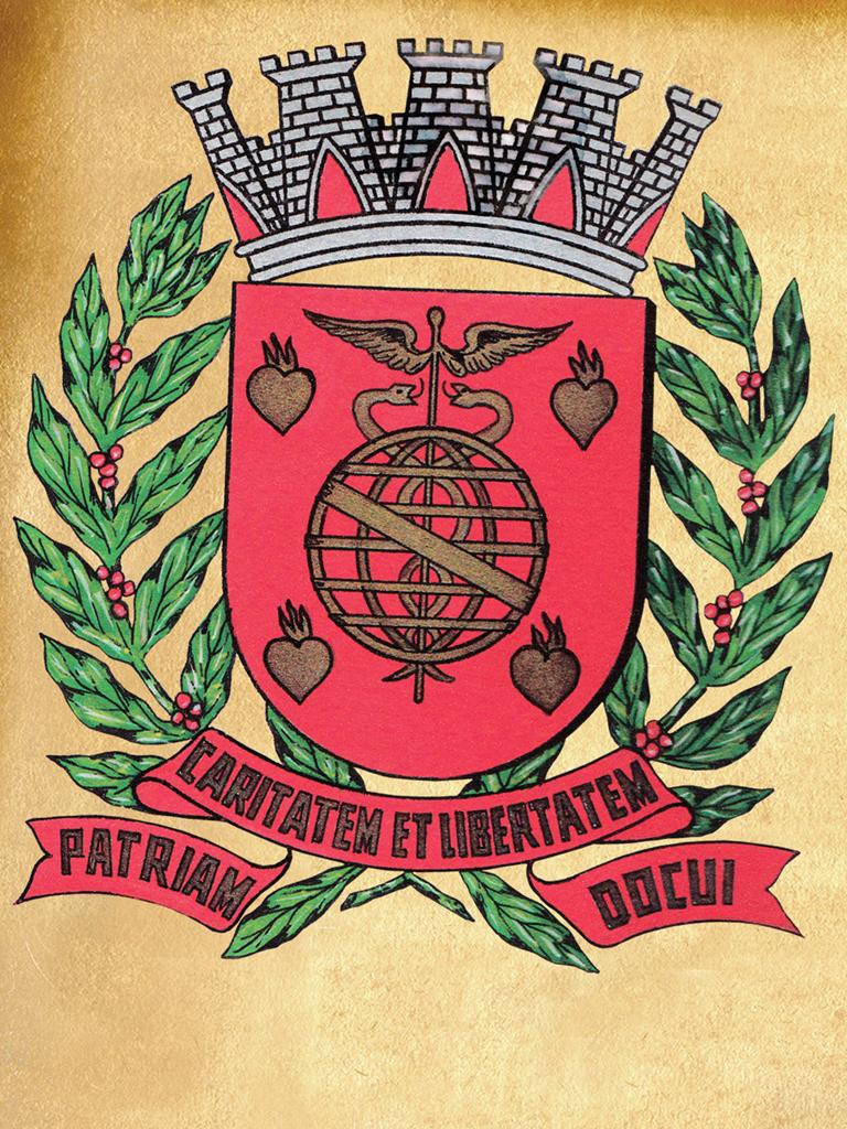 O escudo proposto por Lauro Ribeiro Escobar. Ele já havia tirado os ramos de cana-de-açúcar, mas tinha mantido os corações flamejantes.